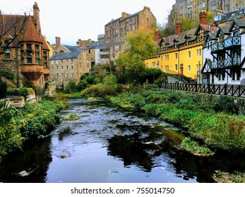 Historic buildings in Dean Village, Edinburgh, Scotland, at Water of Leith river in autumn / fall.
