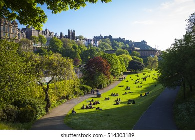 Historic buildings and a green park in Edinburgh, Scotland
