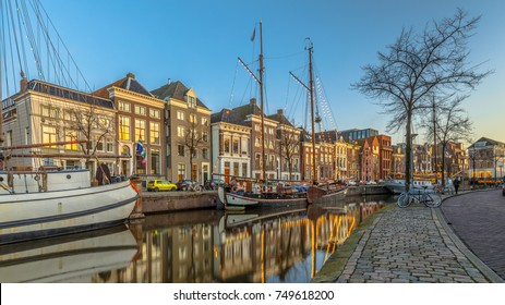 Historic buildings on Hoge der Aa Quay with ship in Groningen city centre at sunset, Netherlands