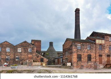 Historic buildings of potteries with bottle oven located on banks of Trent and Mersey canal in Stoke on Trent, Staffordshire,Uk.Popular tourists attraction and destination.Industrial architechture.