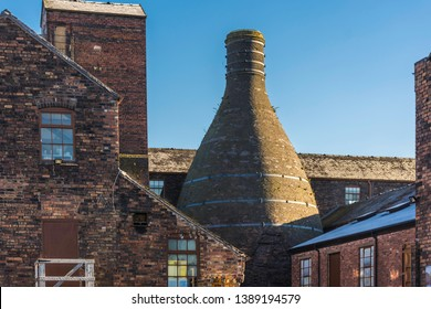 Historic buildings of potteries with bottle oven located on banks of Trent and Mersey canal in Stoke on Trent, Staffordshire,Uk.Popular tourists attraction and destination.Industrial architecture.