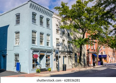 Historic Buildings with Shops and Restaurants in Old Town Alexandria, VA, on a Sunny Day.