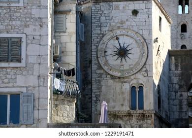 Historic buildings in Split, Croatia with landmark city clock. Split is popular coastal travel destination.