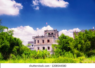 The historic buildings of world heritage site, Kaiping Diaolou in Zili village in Kaiping China in Guangdong province on a sunny blue sky day.