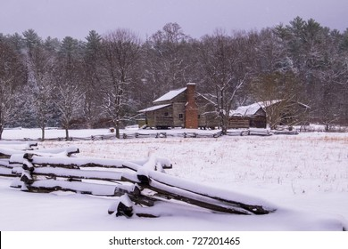 A historic cabin in the snow at Smoky Mtn Nat'l Park's Cades Cove
