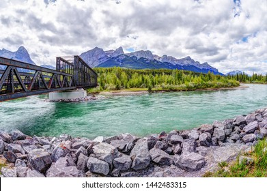 Historic Canmore Engine Bridge over the Bow River in the Canadian Rockies with Ha Ling Peak and Mt Rundle in the background. The railroad bridge was built in 1891 but is now the Bow River hiking loop.