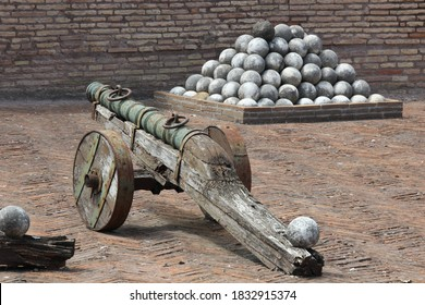 Historic cannon with cannon balls