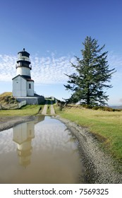 Historic Cape Disappointment Lighthouse on high bluff,  Oregon Coast