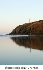 Historic Cape Disappointment  Lighthouse on high bluff on Oregon Coast at sunset