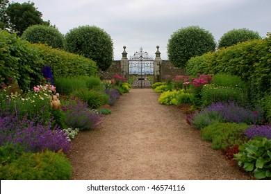 Historic castle garden with old iron door, scotland, UK