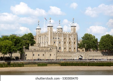 The historic castle Tower of London with a cloudy blue sky. view of the Traitors Gate, UK