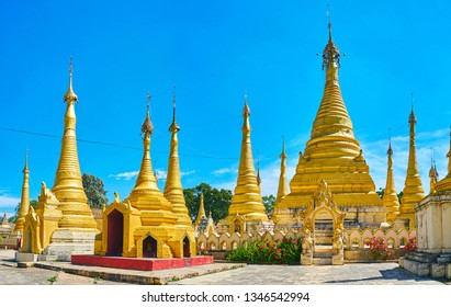 Historic cemetery of Kan Tu Kyaung monastery in Pinday is decorated with ornate gilded stupas and flower beds, Myanmar.