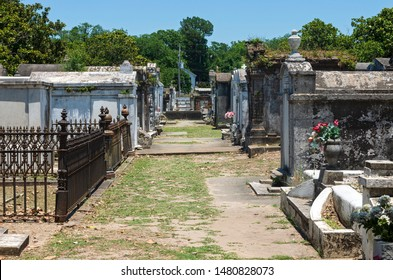 historic cemetery with mausoleums and tombs above ground to honor the deceased in new orleans