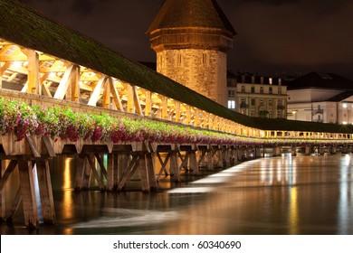 Historic Chapel bridge spanning a river (Reuss) in Lucerne Switzerland