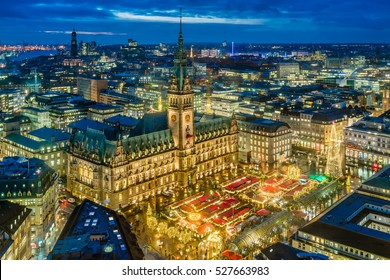 Historic Christmas market on Rathausmarkt in downtown Hamburg, Germany in the evening. Woodcarvers, gingerbread bakers, ceramics artists, silversmiths and many others welcome you.