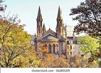Historic church building surrounded by fall foliage in Aberdeen, Scotland
