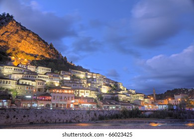 historic city of Berat in Albania at night with all lights flashing with white houses gathering on a hill also called city of a thousand windows