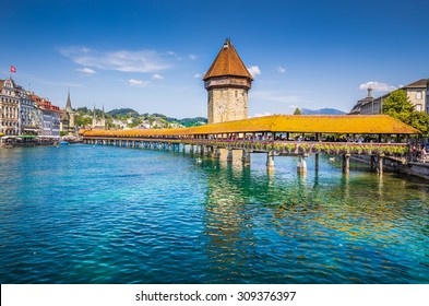 Historic city center of Lucerne with famous Chapel Bridge, the city's symbol and one of the Switzerland's main tourist attractions on a sunny day in summer, Canton of Lucerne, Switzerland