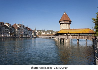 Historic city center of Lucerne with famous Chapel Bridge and Mount Pilatus summit in the background  with blue sky, Canton of Lucerne, Switzerland