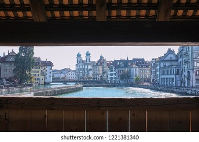 Historic city center of Lucerne (Luzern) with famous Chapel Bridge in Switzerland. Cityscape view of Lucerne with the Kapellbrucke bridge, Wasserturm Tower, and the Church of the Jesuits. Wooden frame