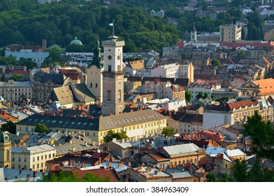 The historic city center of Lviv, old houses in the old town, Tower of City Hall on the Market Square. Lvov, Ukraine