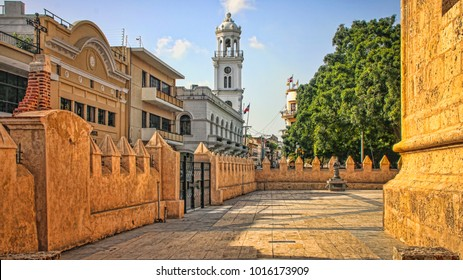 Historic City Center Plaza with Skyline of Colonial Buildings and Church (Santo Domingo, Dominican Republic).