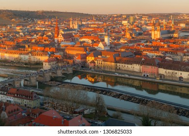 Historic city of Wurzburg at the sunset with bridge Alte Mainbrucke, Germany.