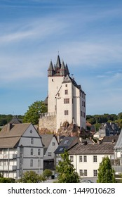 historic Diez castle at river Lahn , Rhineland-Palatinate, Germany. Fairytale view of castle from old town. Historic half-timbered houses in center of city .