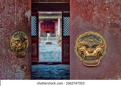 Historic Door Knockers on Buddhist Temple with view of Inner Courtyard (Ulaanbaatar, Mongolia).