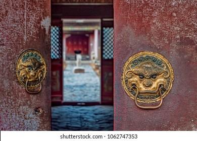 Historic Door Knockers on Buddhist Temple with view of Inner Courtyard (Ulaanbaatar, Mongolia).