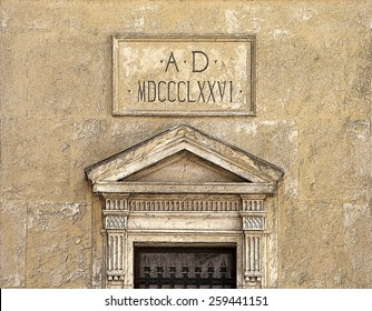 Historic doorway on stone building with the date in Roman numerals