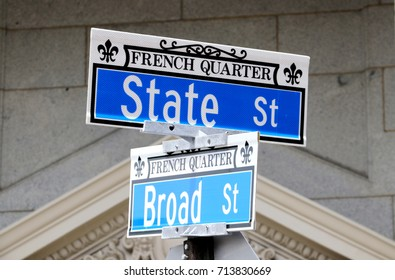 Historic downtown area city of Charleston, South Carolina, USA. Signs with street names on their intersection at the French quarter in the historic downtown city of Charleston.