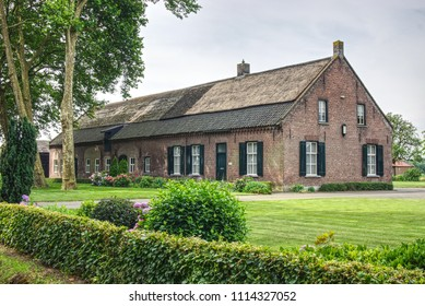 Historic Dutch long gable farmhouse, typically as seen in south-east of Brabant, built around 1900, at Vloeiweg in Deurne, a village in the Provence of Brabant in the Netherlands.