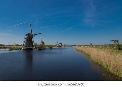 Historic Dutch windmills on the polders in Kinderdijk, South Holland, Netherlands, UNESCO World Heritage Site