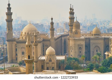 Historic ensemble of Salah El-Deen square from the Saladin Citadel, overlooking the domes and minarets of Al Rifai', Sultan Hassan and Al-Mahmoudia mosques, Cairo, Egypt.