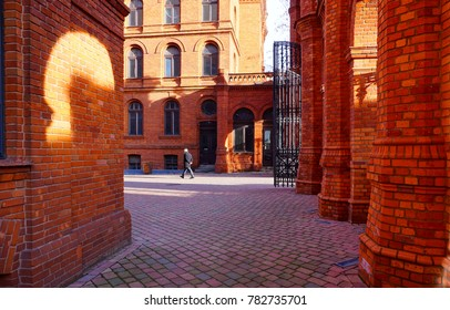 Historic entrance gate.Inner square of Manufaktura, an arts centre, shopping mall, and leisure complex in Lodz, Poland