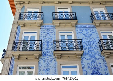 Historic facade in Porto decorated with blue hand painted tin-glazed tiles azulejo Porto, Portugal