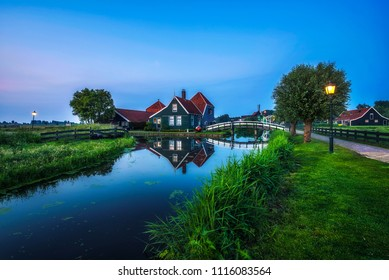 Historic farm houses in the beautiful holland village of Zaanse Schans near Amsterdam at night.