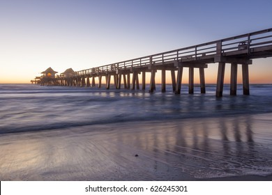 Historic fishing pier in Naples at sunset. Florida, United States