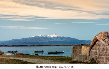 Historic fishing village with the Étang de Canet-Saint-Nazaire and the mount Canigou in Canet-en-Roussillon France