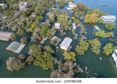 Historic Flooding aerial drone view above Homes and Houses under water after Central Texas Flooding half way under water only rooftops above flood waters lake Travis Austin Texas historic flooding