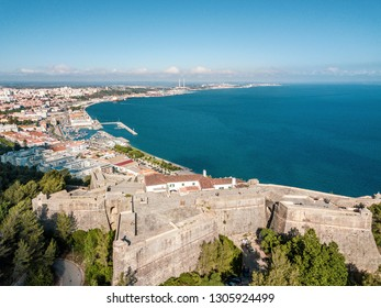 Historic fortress Sao Filipe rising above modern Setubal, Portugal