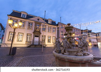historic fountain on the townhall place lippstadt germany in the evening