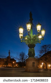Historic gas street lamp on a Castle square in Prague, Czech Republic. Beautiful ornamental candelabra with 8 arms, technical monument made of cast iron in 1876