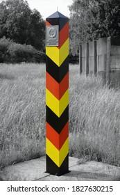 Historic German Democratic Republic (GDR, East Germany) border column. Former Inner German border. In the background the border fence.