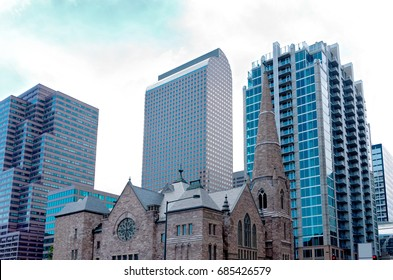 historic gothic church against skyline of modern skyscrapers in downtown denver colorado