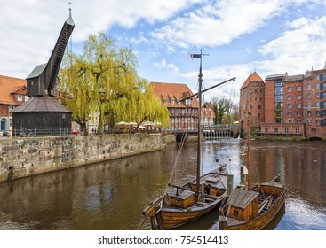 The historic harbor of Luneburg, the Old Crane and restored medieval ships