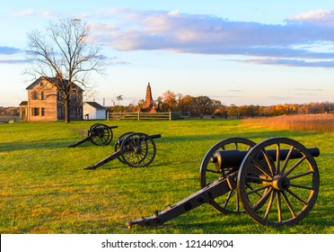 Historic Henry House and cannons at Manassas National Battlefield Park during sunset