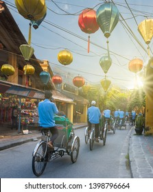 Historic HOIAN town paper lanterns and bicycle taxis, is a touristic tool for visiting historic streets, Vietnam