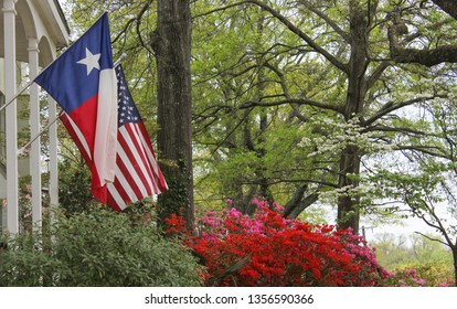 Historic Home With Texas and American Flags
